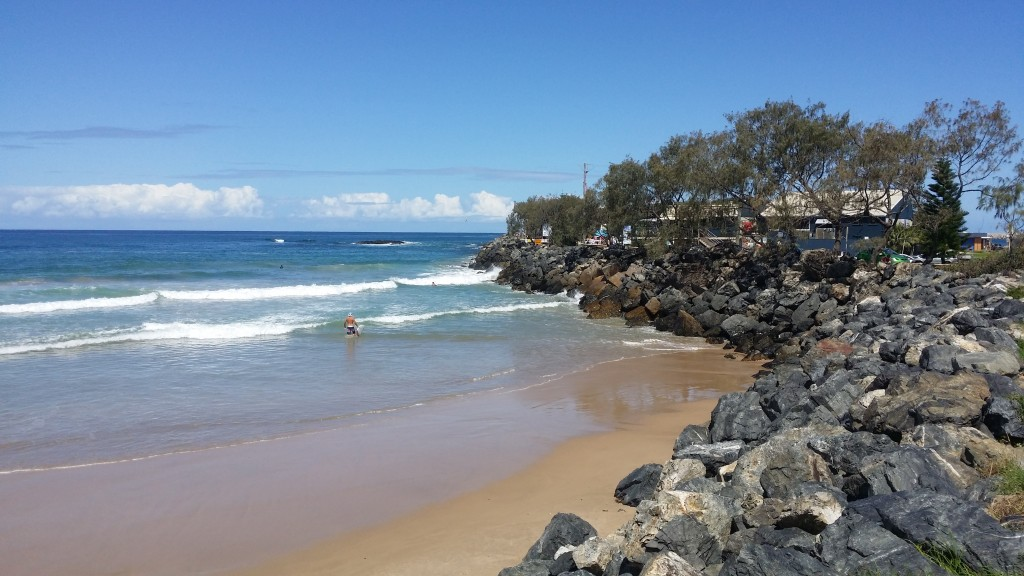Surfers enjoying the water near the Coffs Jetty.